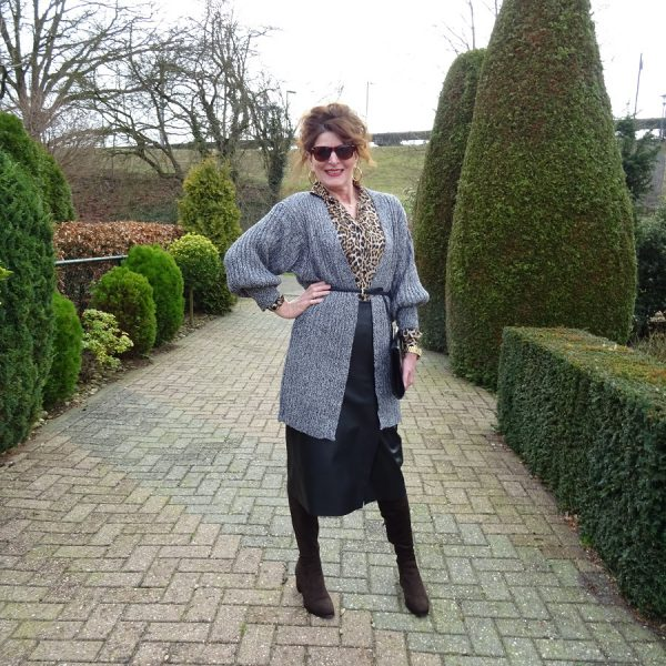 outfit with leather skirt, grey cardigan and leopard print blouse