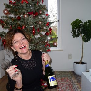 Me sitting by the Christmas tree with champagne