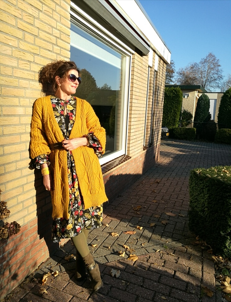 yellow knitted cardigan on a floral dress