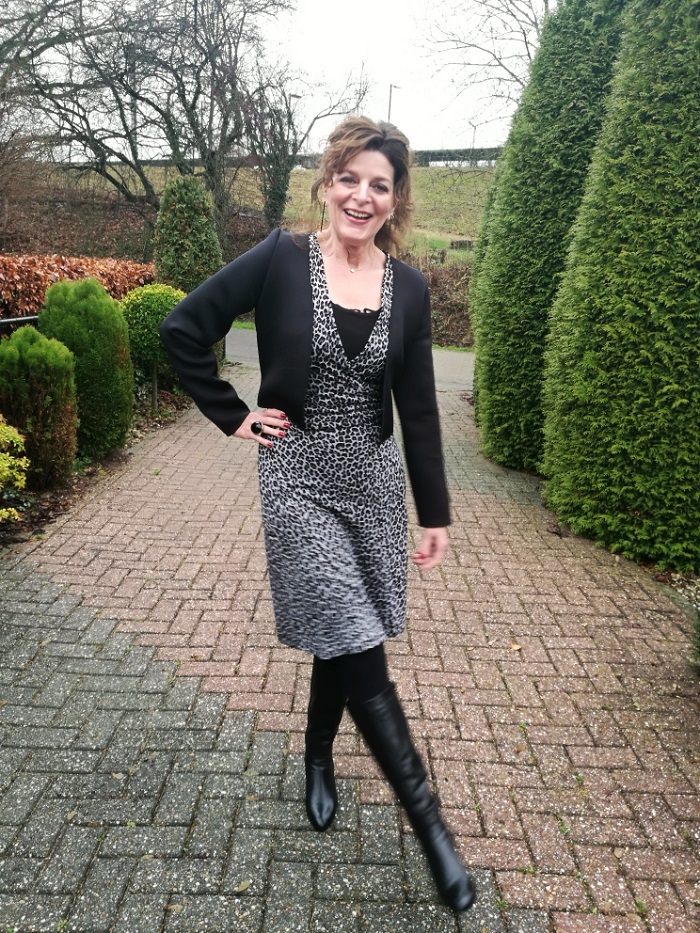 Grey leopard print dress with black cardigan and black boots