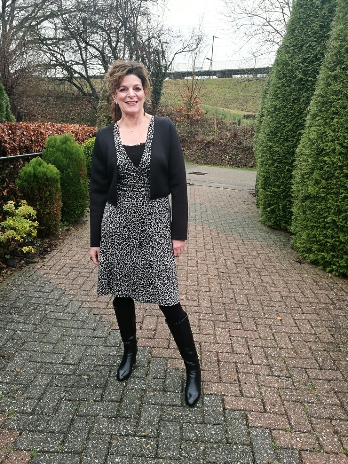 Grey leopard print dress with black jacket and black boots