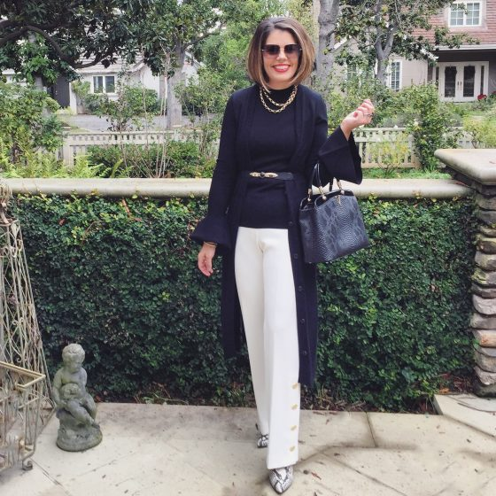 black long cardigan on white trousers