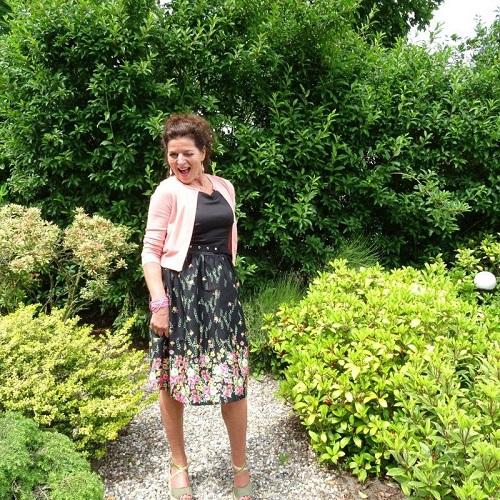 Floral black dress and soft pink short cardigan