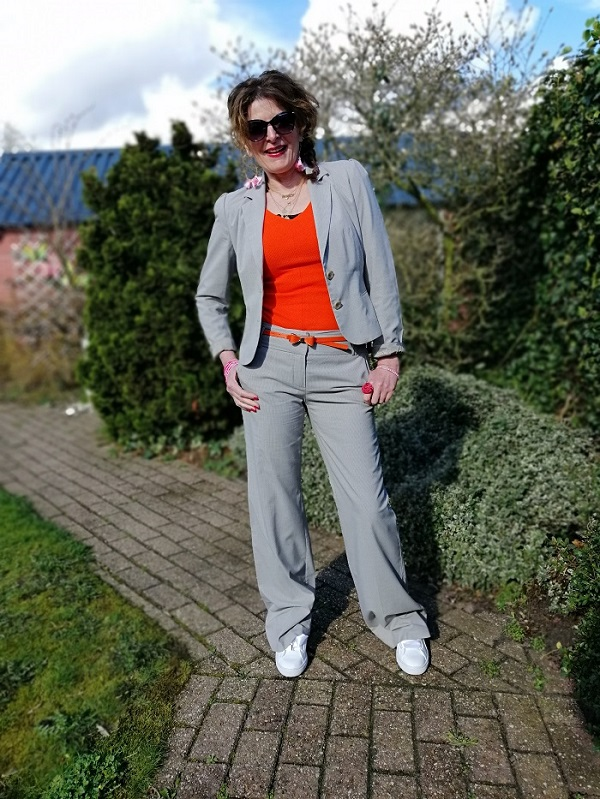 me in a grey suit with orange top