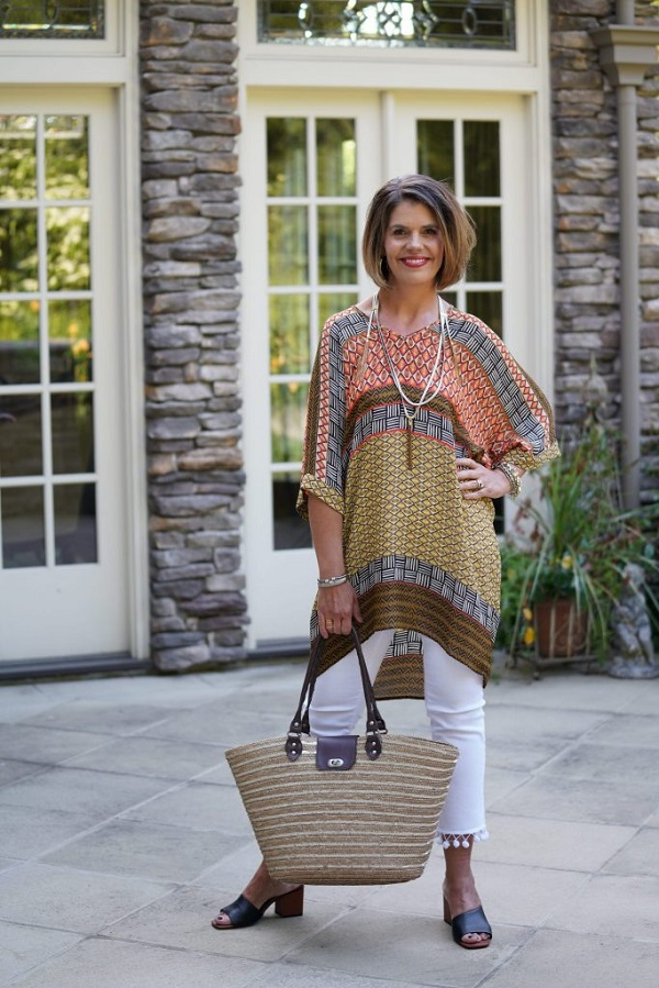 white jeans and a tunic in orange and brown
