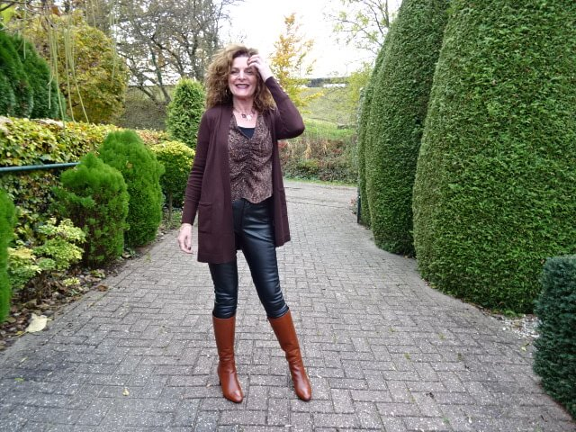 black leather leggings and brown boots