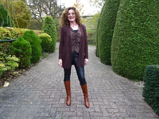 faux leather leggings with brown cardigan