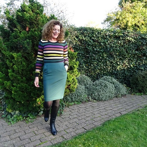 green outfit in skirt and sweater