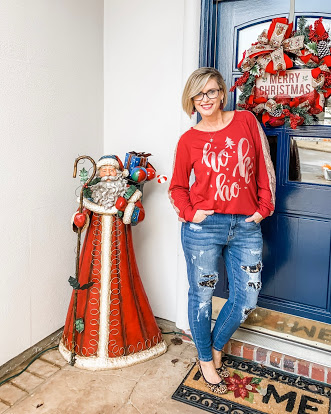 holiday look with jeans and a sweater