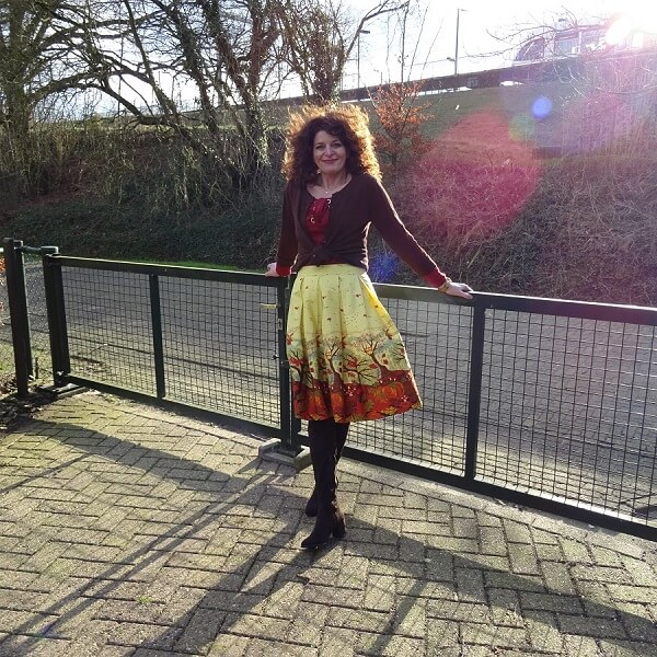 brown cardigan and yellow brown skirt