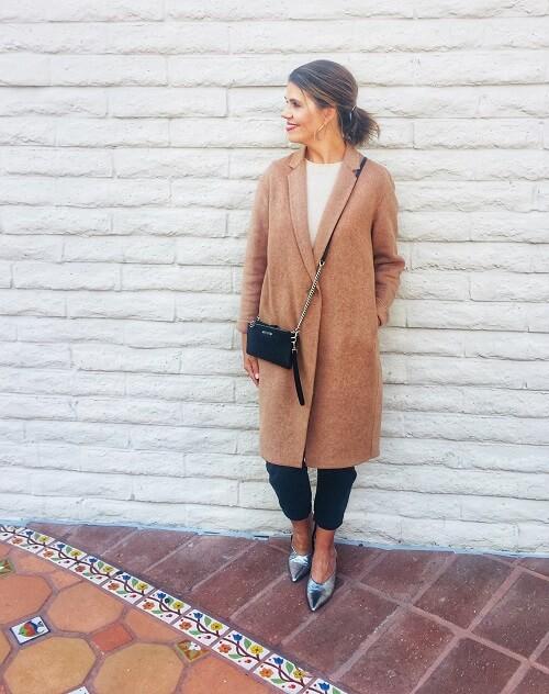 fashion blogger in beige teddy coat