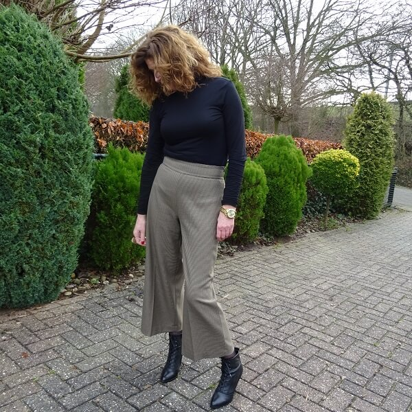 black turtle neck and culottes