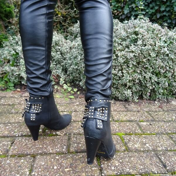 studded ankle boots with a bow