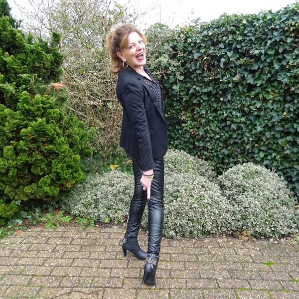 Black blazer on leather trousers