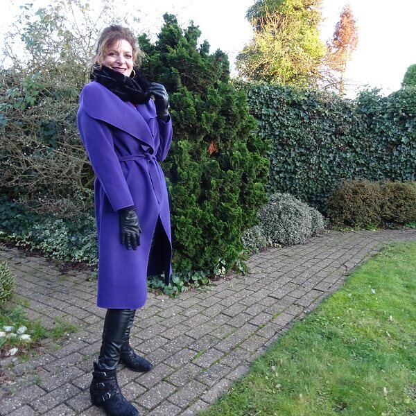 purple coat and faux fur scarf