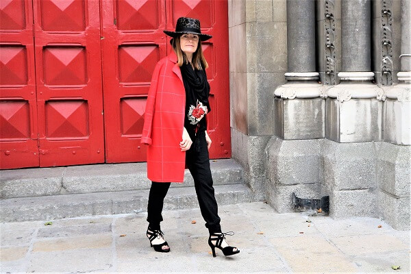 red coat styled by a fashion blogger