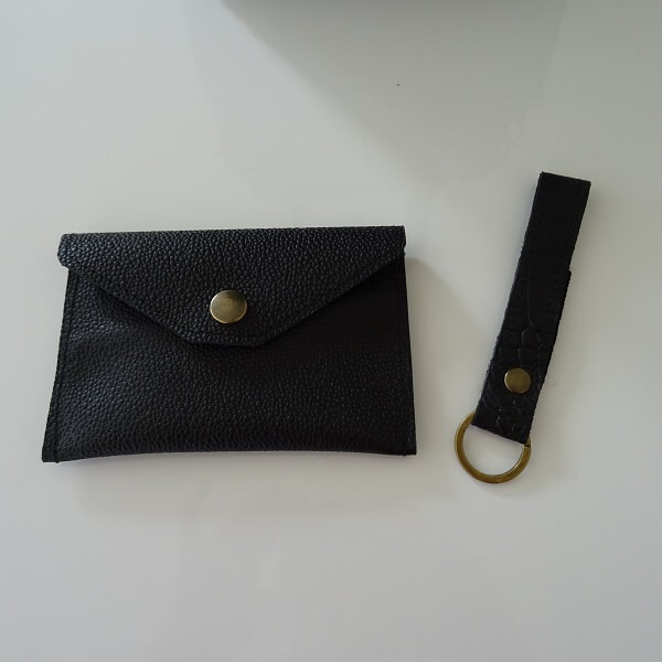 wallet and key cord of black leather