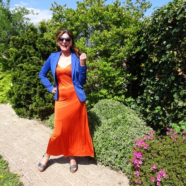 cobalt blazer with burnt orange maxi dress