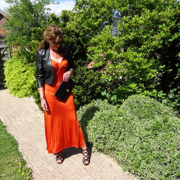 black leather bolero on orange dress