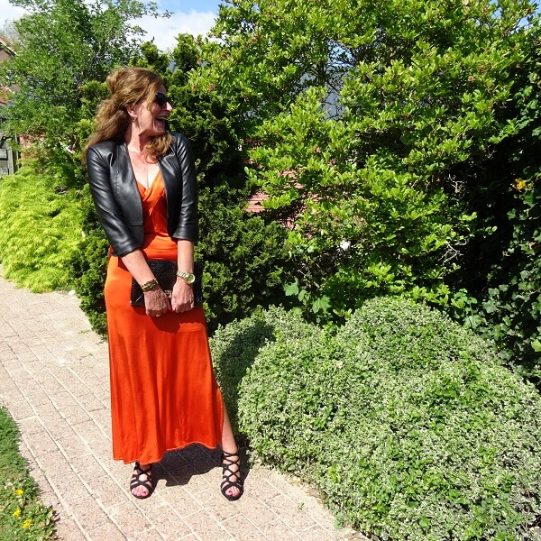 black sandals under a orange dress