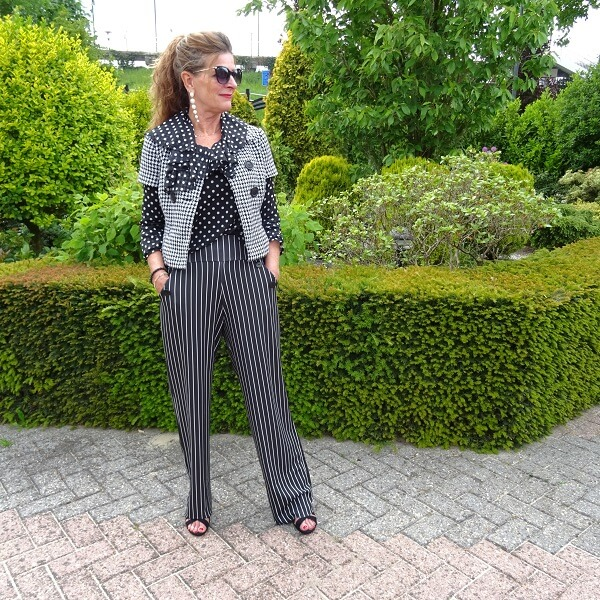 striped trousers and polka dot blouse
