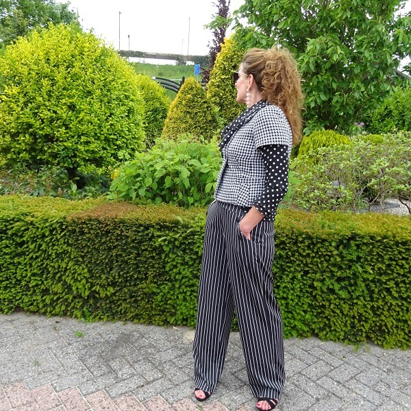 palazzo trousers and ruffled blouse