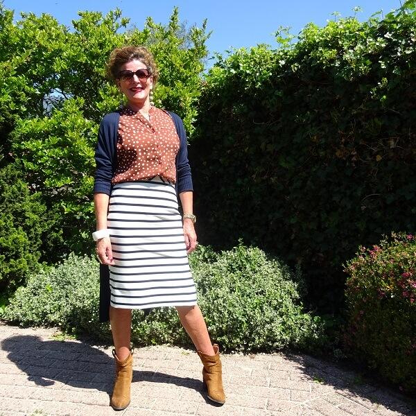 polka dot blouse on striped skirt