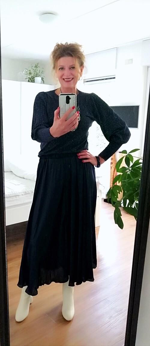 glitter sweater on pleated skirt