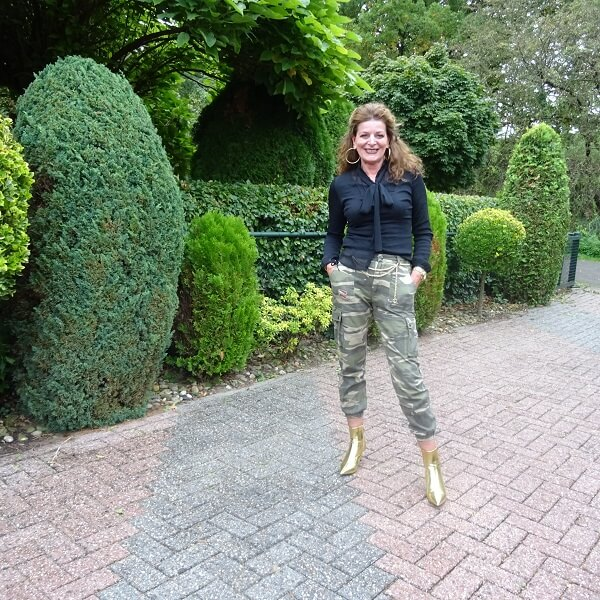 camouflage trousers and pussy bow boots