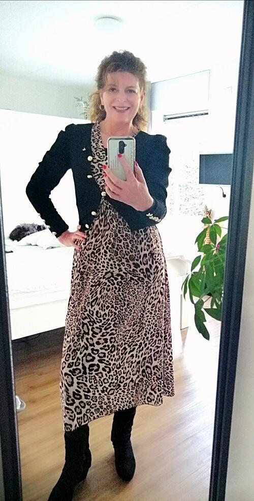 leopard print dress with black cardigan