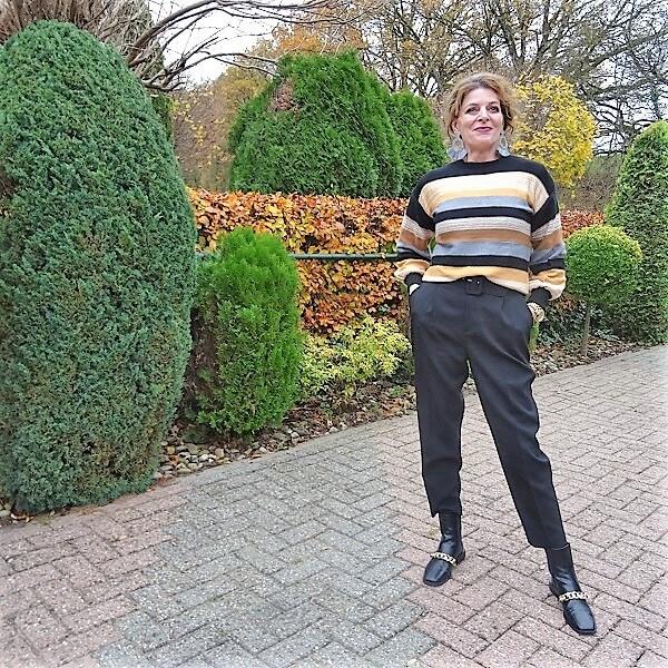 fashion blogger in striped sweater