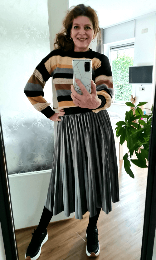 pleated skirt and striped sweater