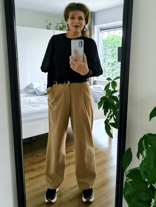 wide legged trousers with black sweater