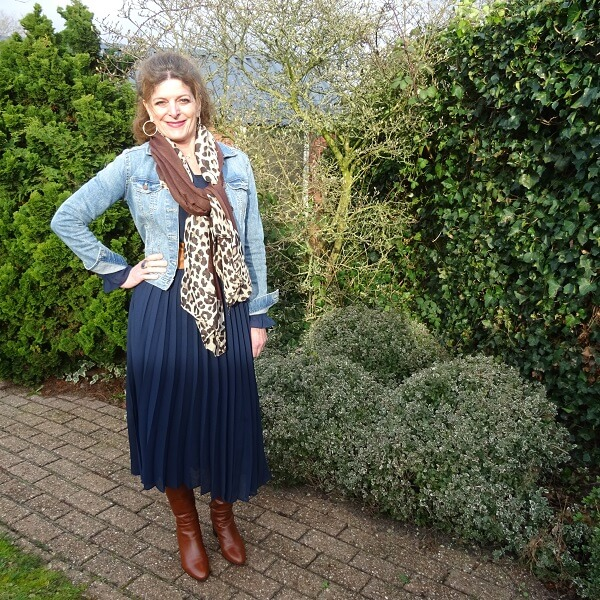 navy pleated dress and brown boots