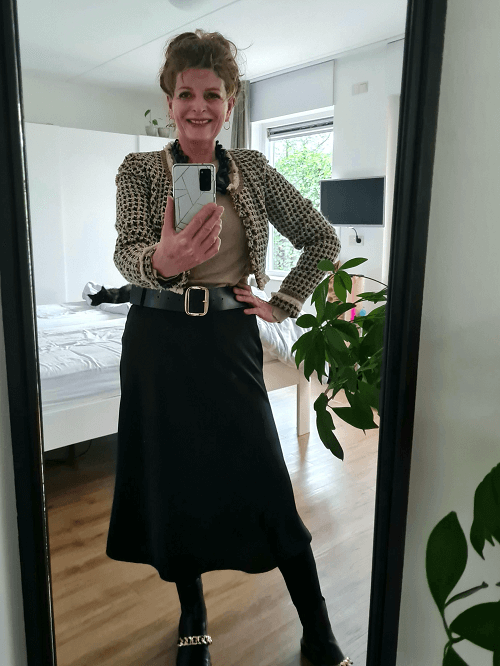 outfit photo with a silk skirt and a tweed jacket