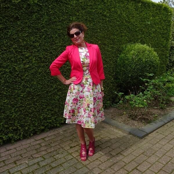 pink blazer on floral pink dress