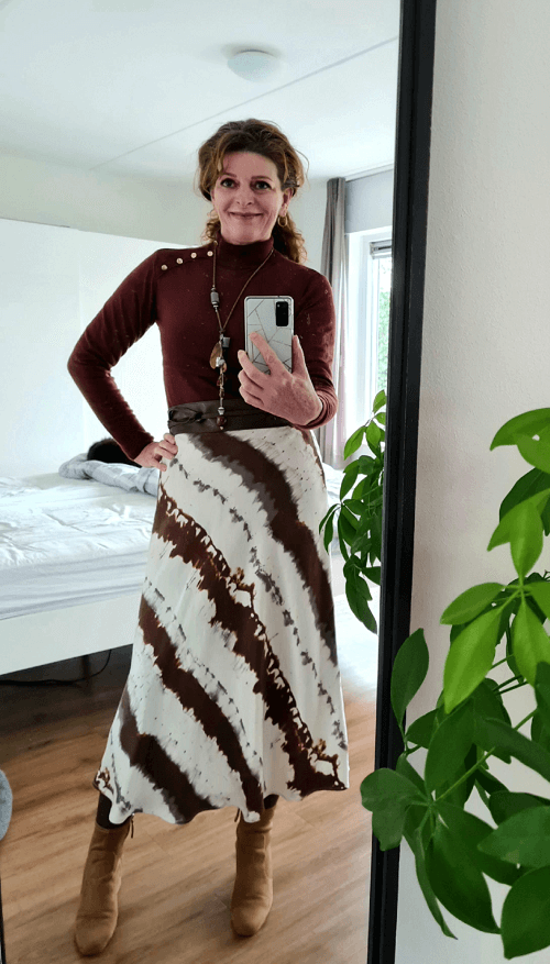 brown outfit with silky skirt and sweater