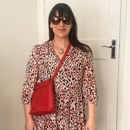 pink tunic and red bag