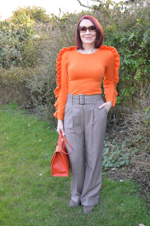 orange statement sweater