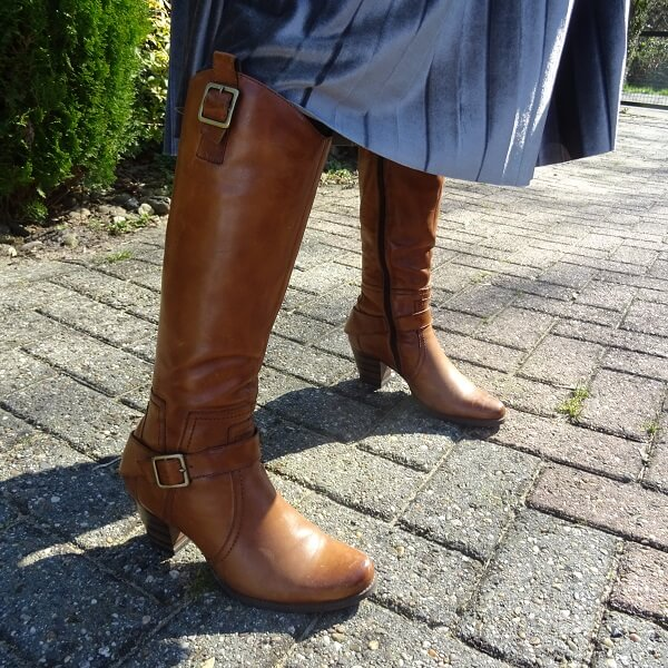 brown boots with golden buckles