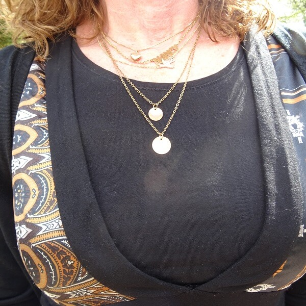 wearing several necklaces