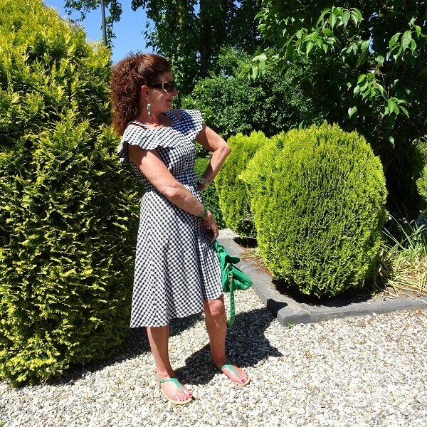 gingham dress in black and white with green bag and shoes