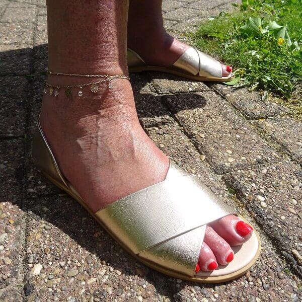 golden sandals and anklets