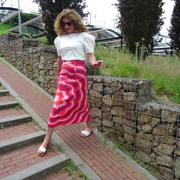white slippers under a pink skirt