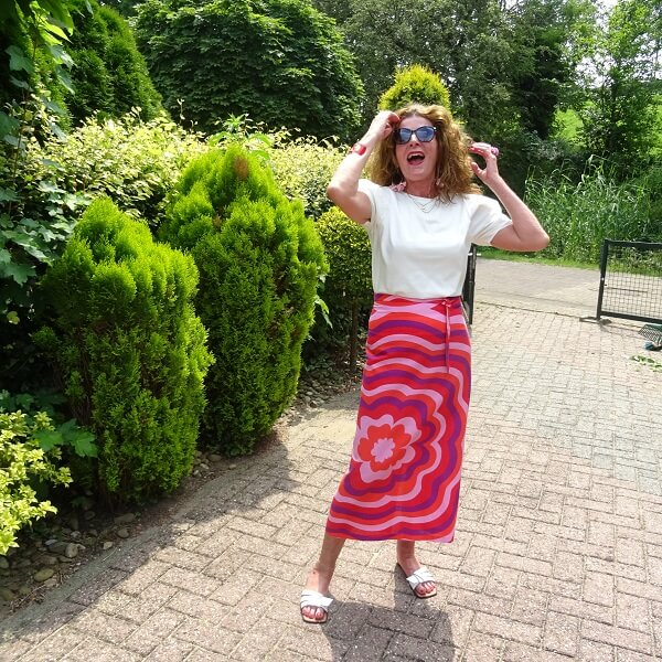 pink linen skirt and white tee with puff sleeves
