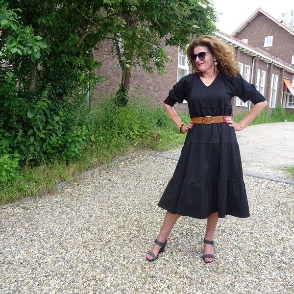 black ruffle dress and grey sandals