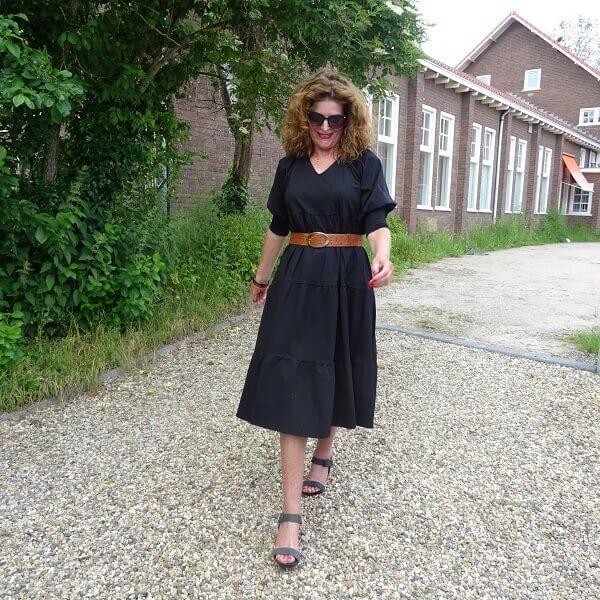 black wide dress with brown belt