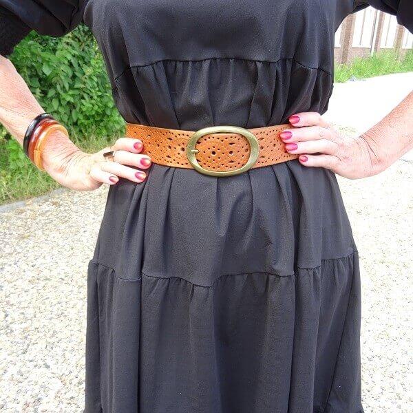 brown belt on black dress