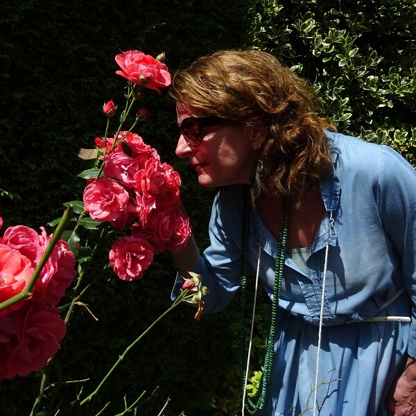 me smelling at our roses