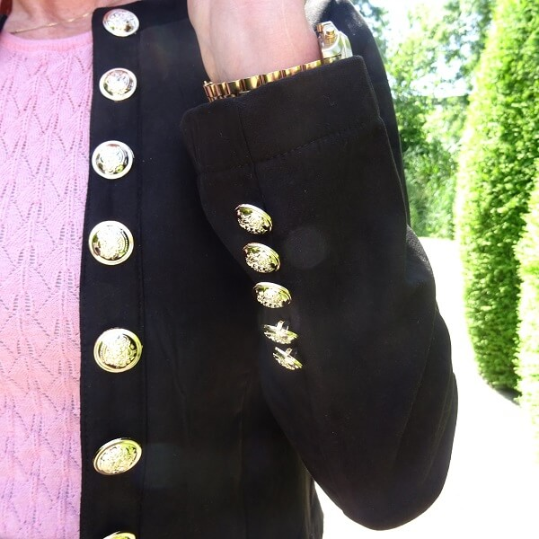 black jacket and golden buttons